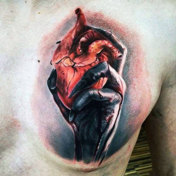 Hand Holding Heart Guys Realistic Upper Chest Tattoo