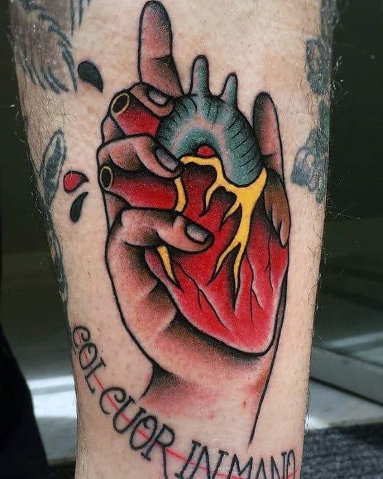 Hand Holding Heart Traditional Mens Tattoo Ideas