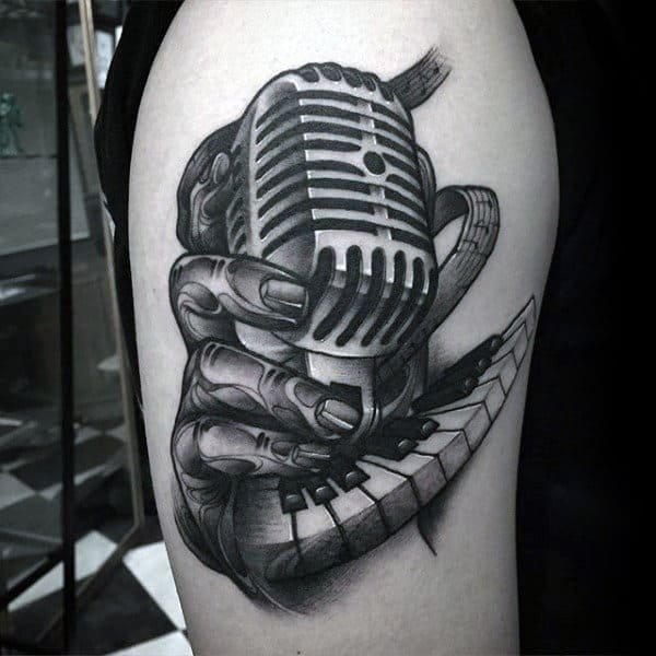 Hand Holding Microphone With Piano Keys Mens Arm Tattoos