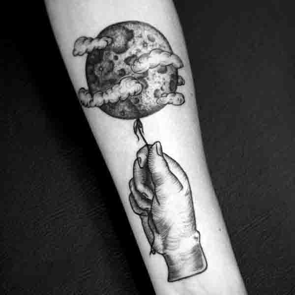 Hand Pulling Moon By A String Tattoo For Males On Forearm
