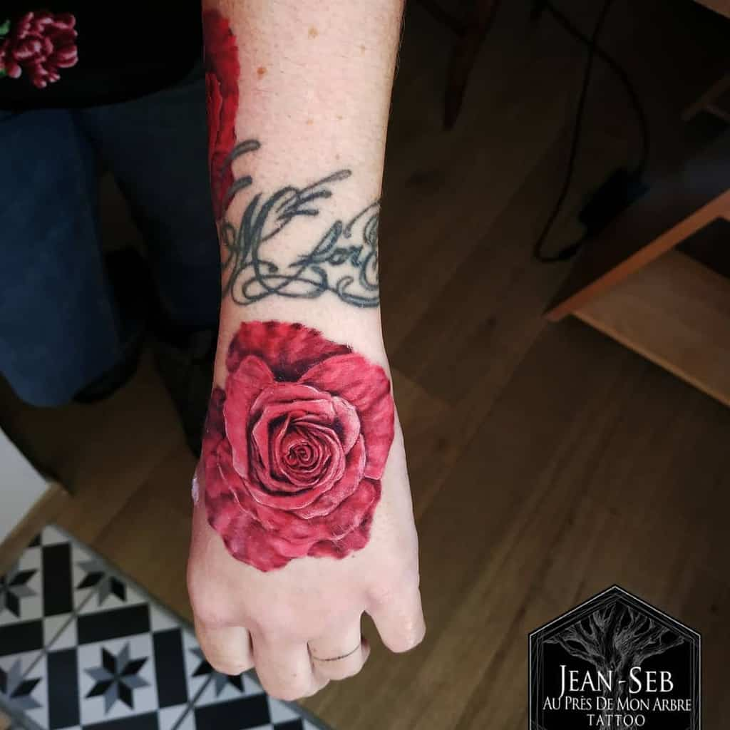hand red rose tattoos jeansebtatouage