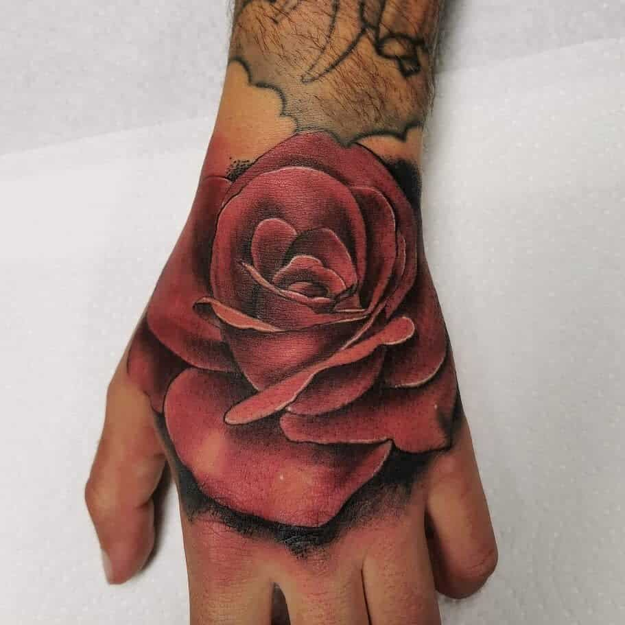 hand red rose tattoos north_road_tattoo_brighton