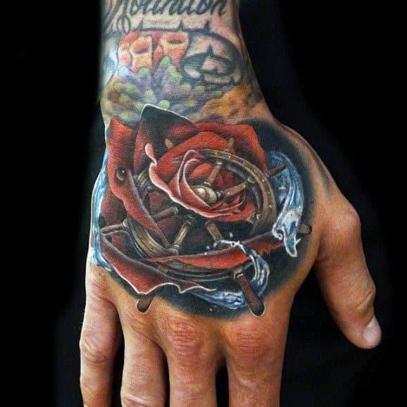 Hand Rose Flower Ship Wheel Tattoo On Male