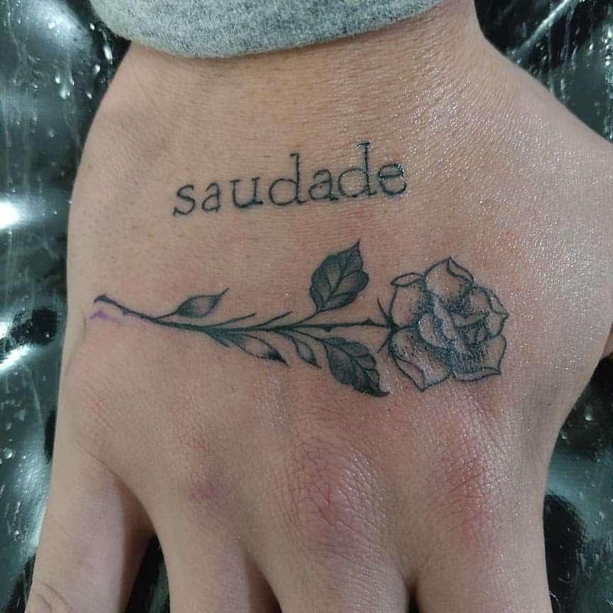 hand rose with stem tattoos anaantunes.tattoo