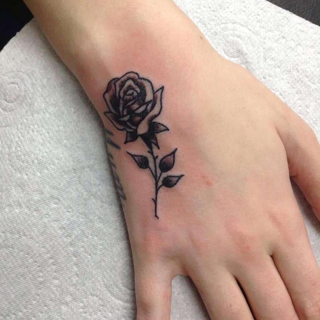 hand rose with stem tattoos thepassingoftime