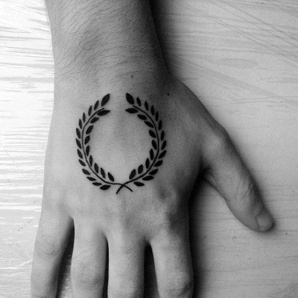Hand Simple Laurel Wreath Tattoo Design On Man