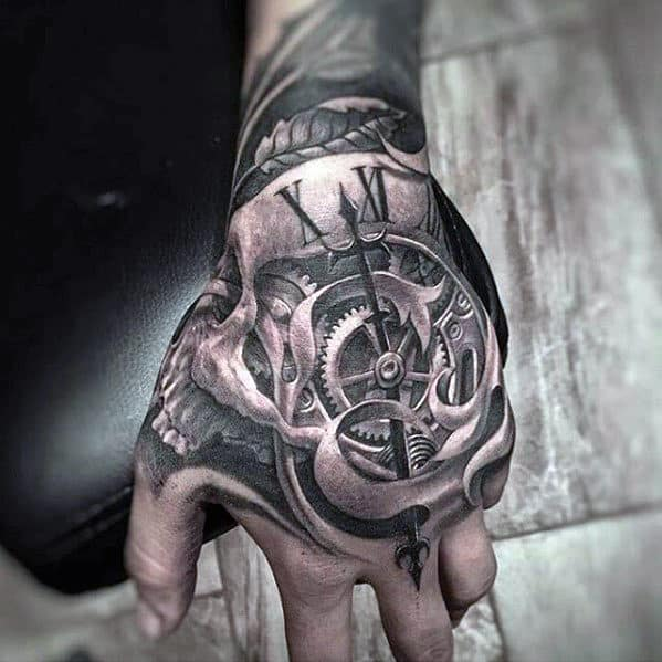 Hand Tattoo For Men With Unbelievable 3d Skull And Clock Design