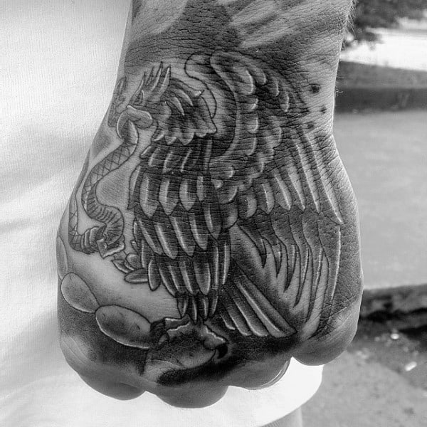 Hand Tattoo Of Mexican Eagle On Male