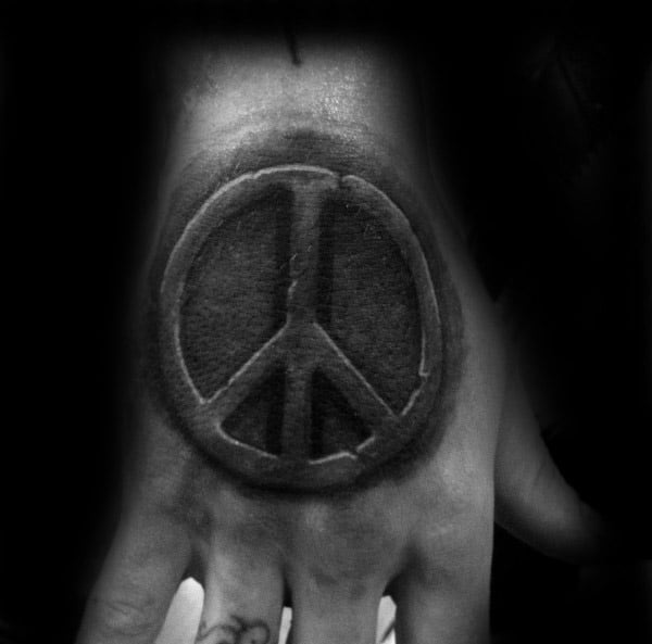 Hand Tattoo Of Stone Peace Sign For Men