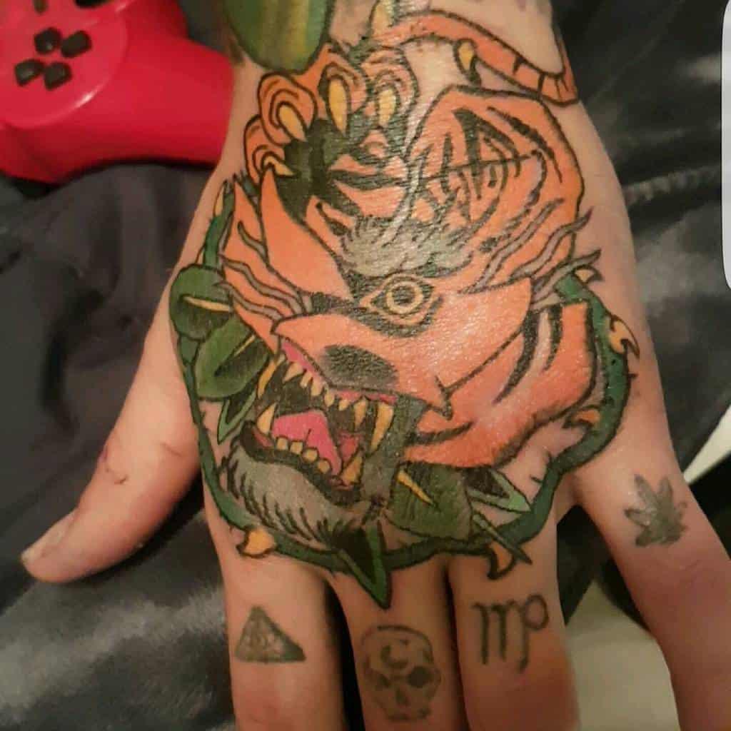 hand tiger rose tattoos jakkecole