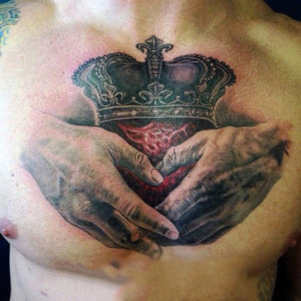 Handings Holding Heart With Crown Claddagh Mens Chest Tattoo