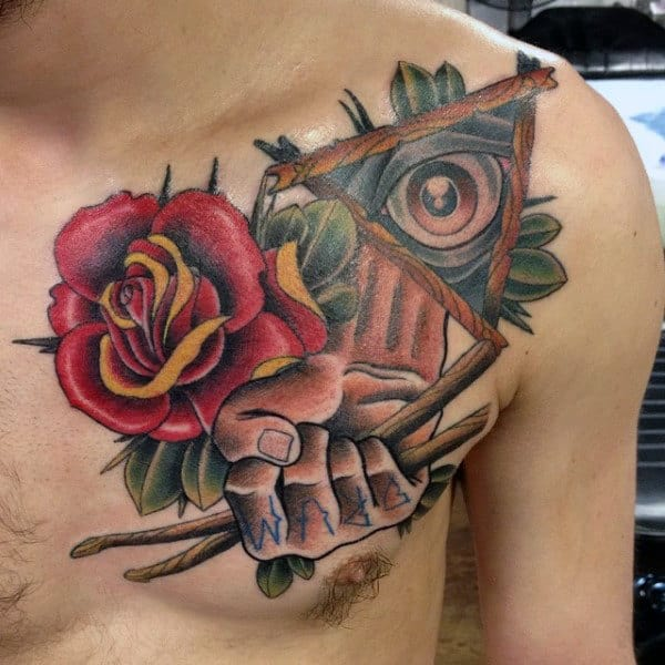 Hands Holding Drum Sticks With Rose Flower Male Upper Chest Tattoo