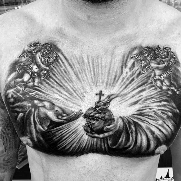 Hands Holding Sacred Heart With Angels Mens Sweet Upper Chest Tattoos