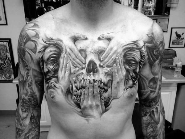 Hands Over Skull Guys Upper Chest Tattoo Designs