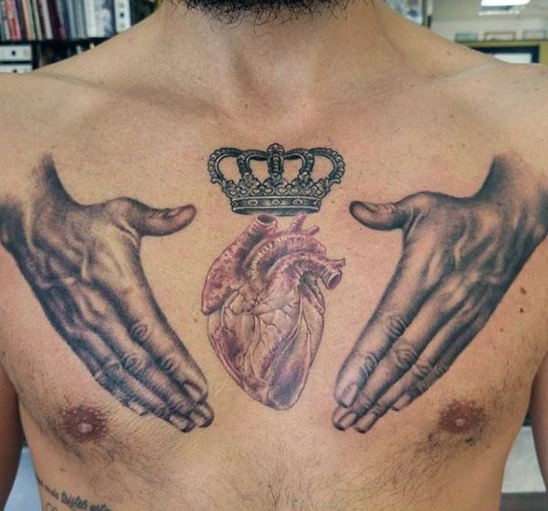 Hands Protecting Crowned Heart Tattoo On Chest For Males
