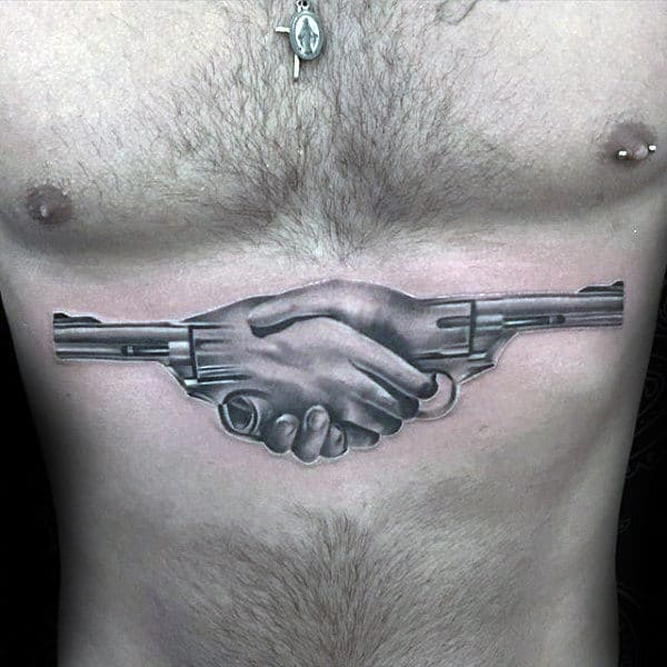 Hands Shaking With Revovlers Creative Mens White And Grey Ink Shaded Chest Tattoo