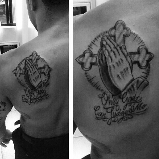 hands with cross and only god can judge me mens shoulder blade tattoo