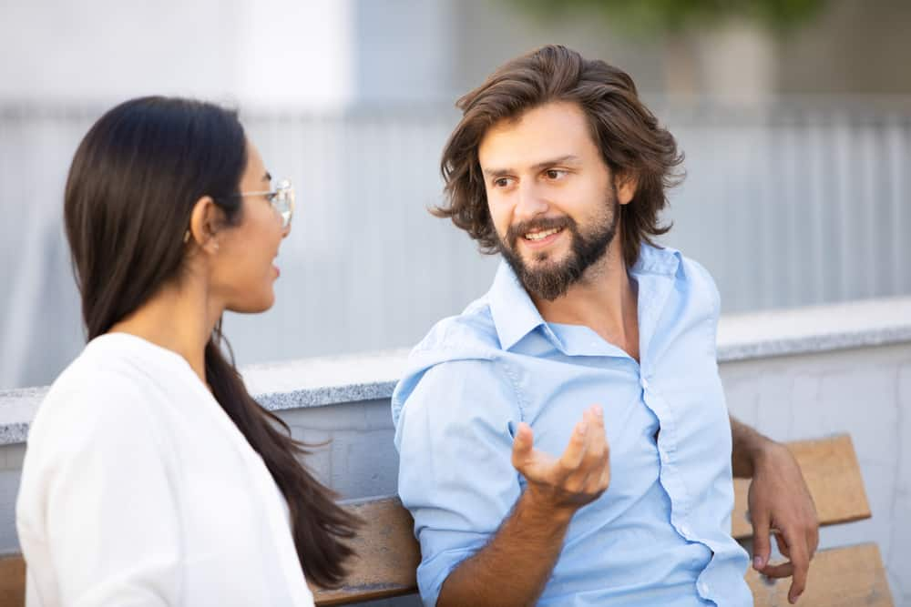 handsome man talking colleague
