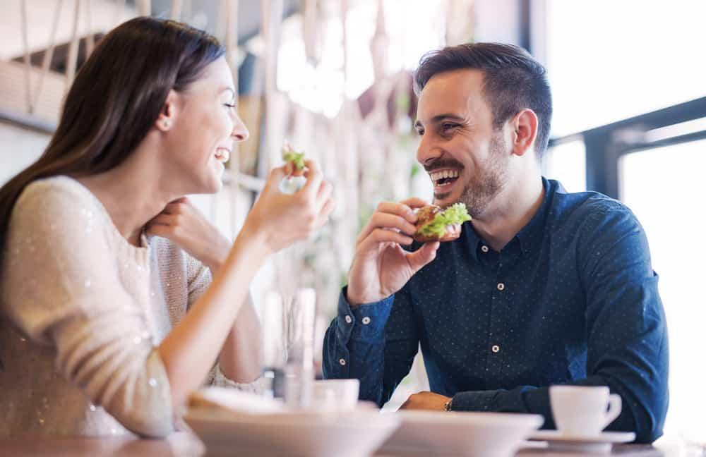 happy couple enjoying breakfast