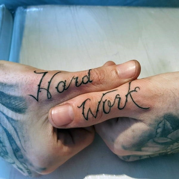 Hard Work Thumb Script Tattoos For Men