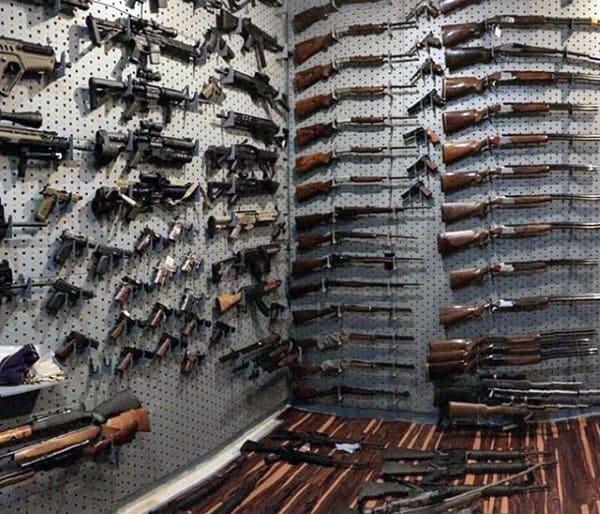 Hardwood Floors In Gun Room With Grey Wall Racks