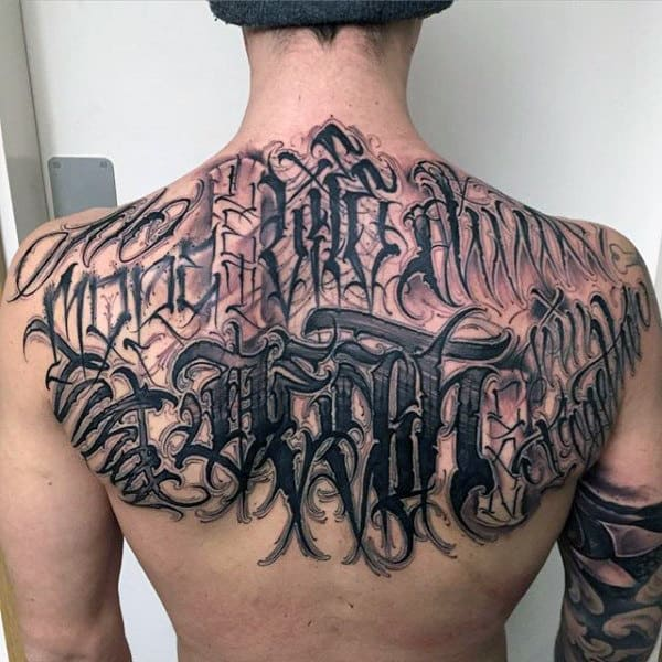 Haunting Black Lettering Tattoo Mens Back