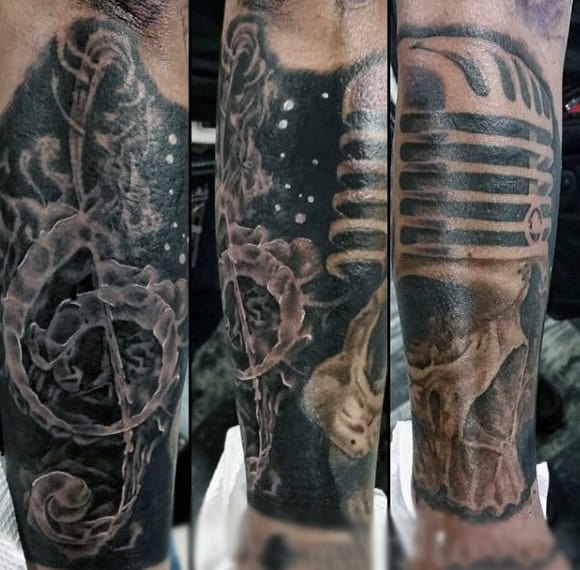 Haunting Dark Musical Skull Tattoo For Men On Legs
