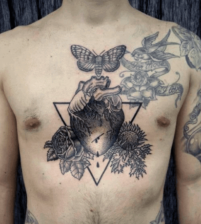 Heart Tattoo On Man Chest Piece In Black Ink With Butterfly