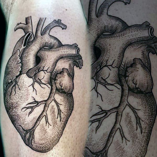 Heart Tattoo On Man With Light Black Ink Shading On Upper Arm
