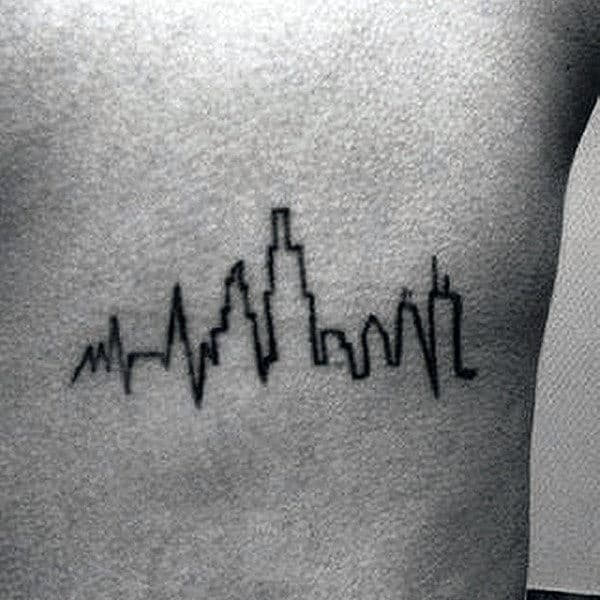 Heartbeat And Building Tattoo Mens Chest