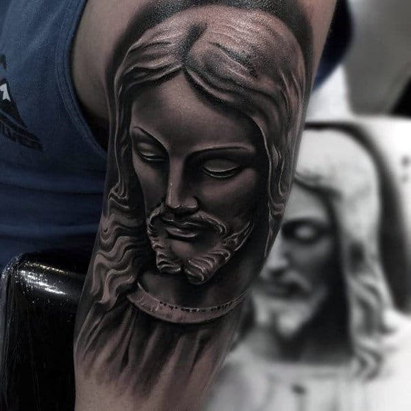 Heavily Shaded Catholic Guys Jesus Portrait Tattoo On Arm