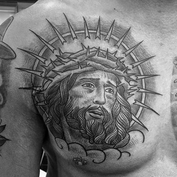 Heavily Shaded Male Jesus Portrait Tattoo On Upper Chest
