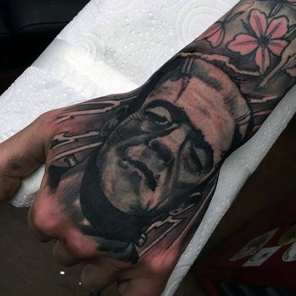 Heavily Shaded Tattoo Of Frankenstein On Gentlemans Hand