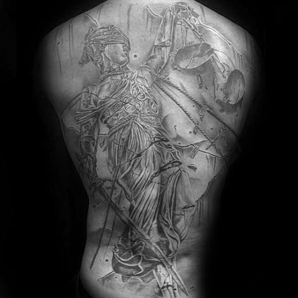 Heavily Shaded Tattoo Of Lady Justice On Mans Back