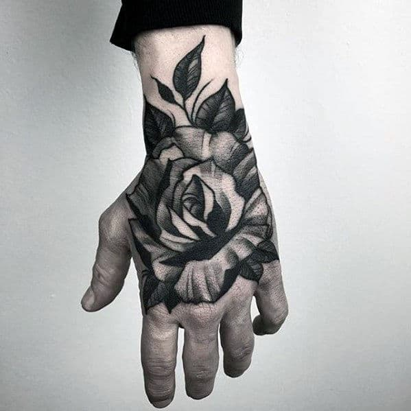 heavily-shaded-traditional-flower-guys-black-and-white-ink-hand-tattoo