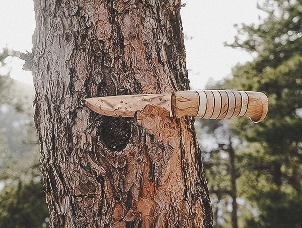 Helle Utvaer Knife Removing Tree Bark Outdoors