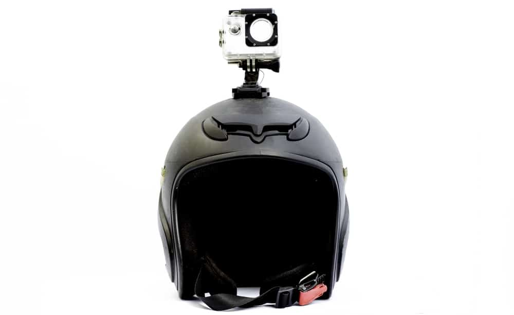 helmet with action camera fitted on top isolated on white background
