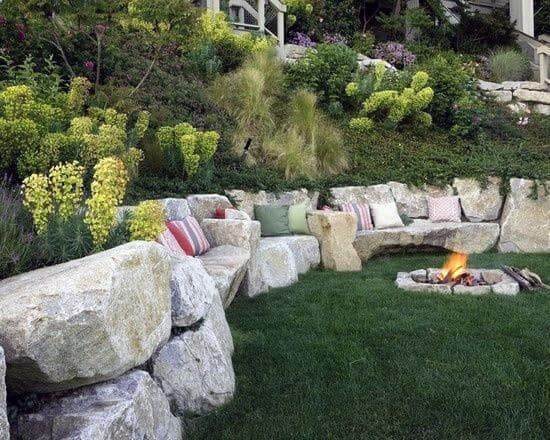Hill Slope Landscaping Ideas Fire Pit Area With Giant Rock Retaining Wall
