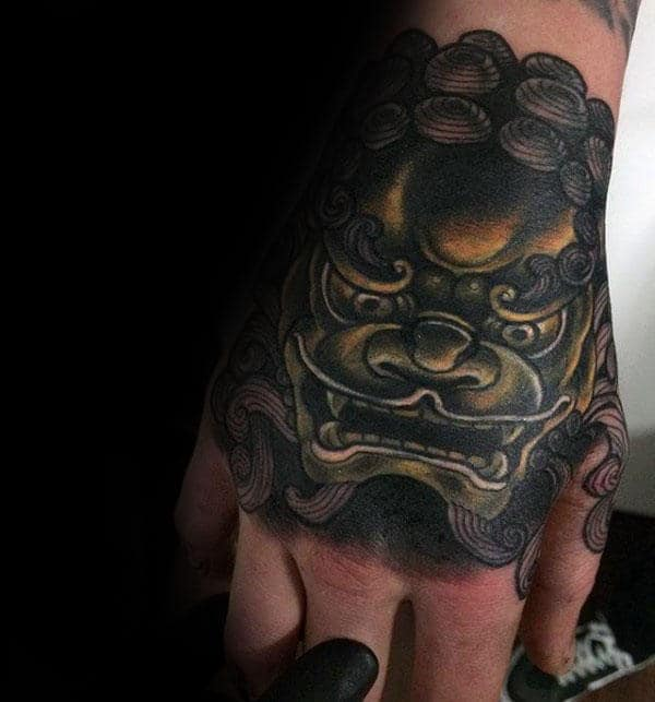 Hold And Black Shaded Foo Dog Mens Hand Tattoos