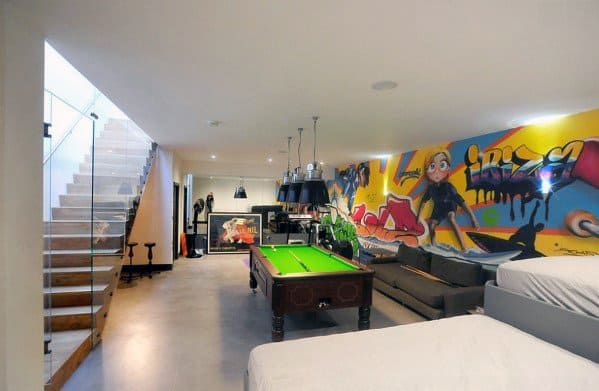 Home Basement Man Cave With Graffiti Walls And Lounge