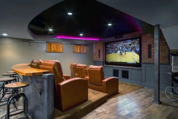 Home Basement With Private Theater Brown Leather Seating And Bar Stools