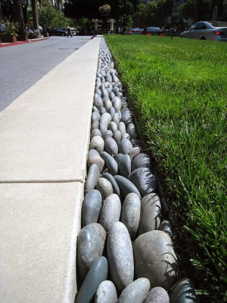 Home Design Ideas Stone Edging Smooth River Rock Border Sidewalk And Grass