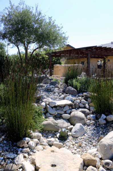 Home Exterior River Rock Landscaping