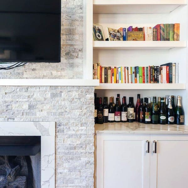 Home Interior Stacked Stone Fireplace With White Bookcases