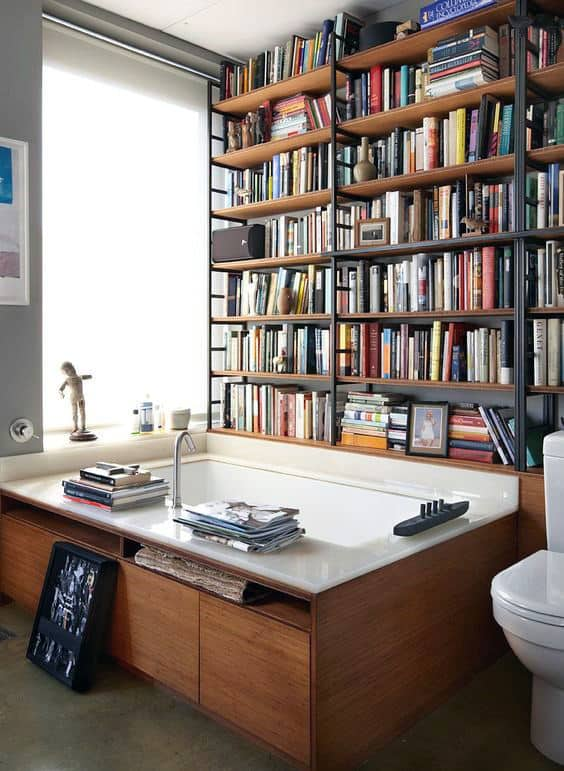 Home Library Book Collection In Bathroom Above Bath Tub