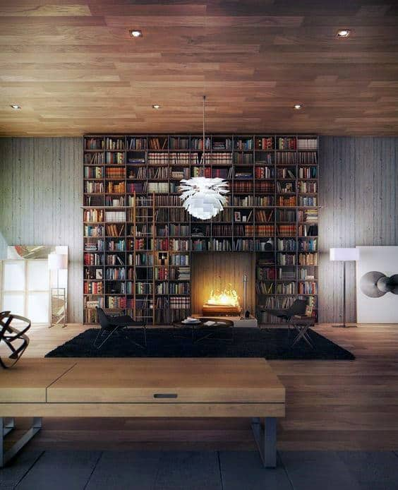 Home Library With Fireplace In Middle Of Book Collection