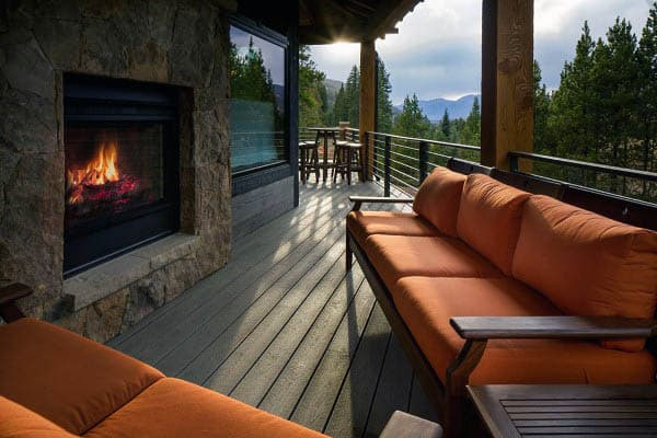 Home With Wood Deck And Outdoor Fireplace Seating Room