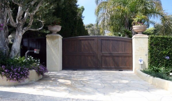 Home With Wood Driveway Gate Design
