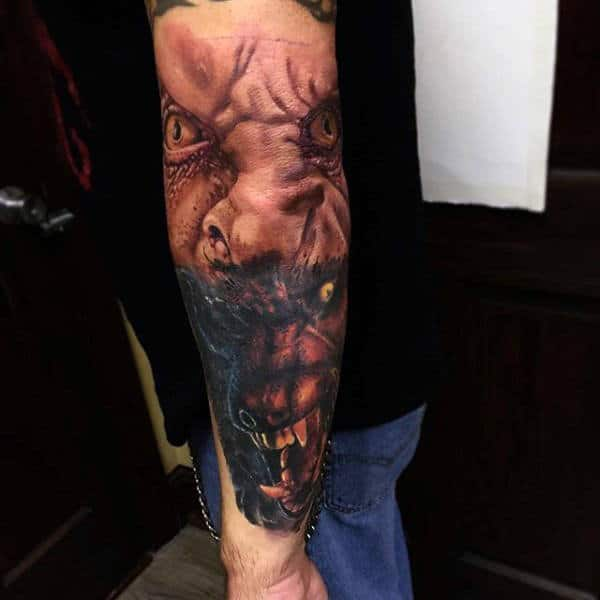 Horrific Werewolf Head And Mans Eyes Tattoo On Male Forearms