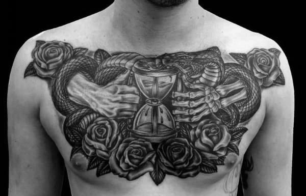 Hourglass Snake With Skeleton Hand Mens Upper Chest Tattoos